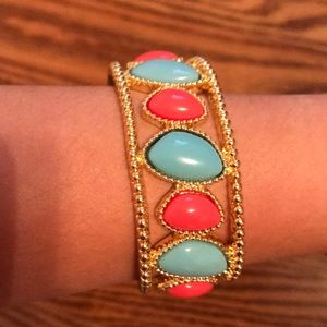 blue and pink stones on a cold clutch bracelet